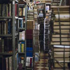 pile of books on gray metal rack 1853836